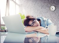 Young female asleep at desk